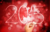 New year 2015 handwriting on the dark red background with bokeh effect