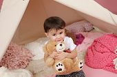 image of teepee tent  - Toddler child kid hugging a stuffed bear toys and teepee tent - JPG