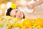 Beautiful Woman Receiving Massage With Herbal Compress Balls