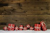 stock photo of ribbon bow  - Wooden rustic background with red christmas presents - JPG