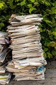 a stack of old newspapers ready for removal by waste paper disposal