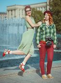 Two Beautiful Hipster Girls With Retro Camera