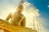 Golden buddha on blue sky, Thailand