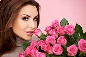 pic of vivacious  - Gorgeous woman with a large bunch of fresh pink roses given her by a loved one for valentines  her birthday or anniversary - JPG