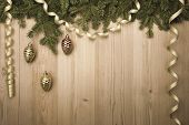 Christmas Vintage Background with fir tree, golden ribbon and decorations like pine cones