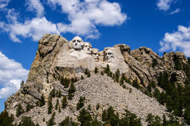 stock photo of mount rushmore national memorial  - The busts of four American presidents are carved into the face of Mount Rushmore