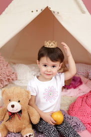 picture of toddlers tiaras  - Toddler child kid engaged in pretend play with princess crown and teepee tent - JPG