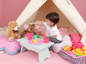 stock photo of girlie  - Toddler child kid engaged in pretend play with food stuffed toys and teepee tent - JPG
