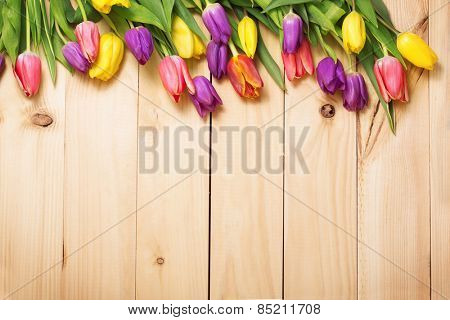 Spring Flowers bunch at wood floor texture. Beautiful Tulips bouquet gift. Easter or Mother\'s Day  b