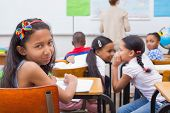 stock photo of misbehaving  - Naughty pupils in class at the elementary school - JPG