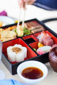 pic of lunch box  - Delicious Japanese lunch bento box with rice - JPG