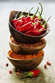 pic of chili peppers  - Red Hot Chili Peppers with herbs and spices over wooden background  - JPG