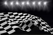 picture of football pitch  - Checkered flag against football pitch at night with lights - JPG