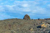 image of volcanic  - Volcanic bomb in front of volcano Montana Colorada in Lanzarote Canary Islands Spain - JPG
