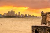 picture of el morro castle  - Beautiful sunset in Havana with El Morro castle on the foreground - JPG
