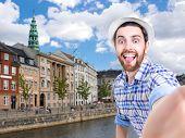 foto of copenhagen  - Happy young man taking a selfie photo in Copenhagen - JPG