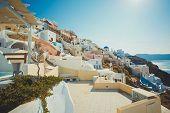 Постер, плакат: Typical and amazing colorful street in Oia city Santorini Greece