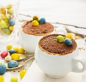 image of easter candy  - Easter cream dessert tiramisu based in portioned cups are decorated sweet candy in the form of eggs - JPG