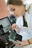 image of driving school  - Student girl in technology fixing computer hard drive - JPG