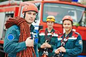 foto of work crew  - firefighters team in uniform in front of fire engine machine and fireman team - JPG