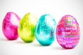 picture of easter candy  - Happy easter in different languages against four easter eggs in a row - JPG