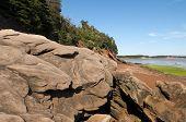image of shoreline  - Large sandstone boulders on the Bay of Fundy shoreline in New Brunswick - JPG