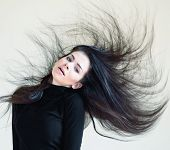 picture of wind blown  - young beautiful woman with a blown hair - JPG