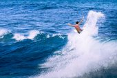 stock photo of watersports  - Extreme surfer riding giant ocean wave in Hawaii - JPG