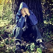 pic of sorrow  - Toned Photo of Sorrowful Young Man in the Forest - JPG