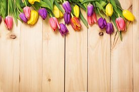 picture of invitation  - Spring Flowers bunch at wood floor texture - JPG