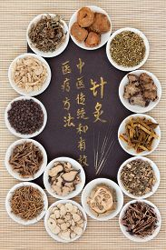 image of chinese calligraphy  - Acupuncture needles and chinese herbal medicine selection with calligraphy script - JPG