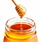 ������, ������: honey Dipping With Honey In Glass Jar Isolated On White Background Macro Wooden Honey Dipper Clos