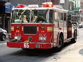 stock photo of fire truck  - fire engine in manhattan street with lights flashing - JPG