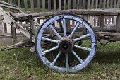 stock photo of wagon wheel  - blue Wooden wheel at an vintage wagon - JPG