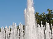 foto of water jet  - Powerful jets of water rising up city fountain - JPG