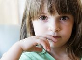 stock photo of cute little girl  - little girl looking nervous - JPG