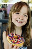 Yummy doughnut being eaten happily by young child
