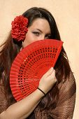 Young spanish woman with red fan.