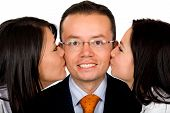 Business Man Being Kissed By Partners