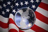 Glass Globe Over Flag