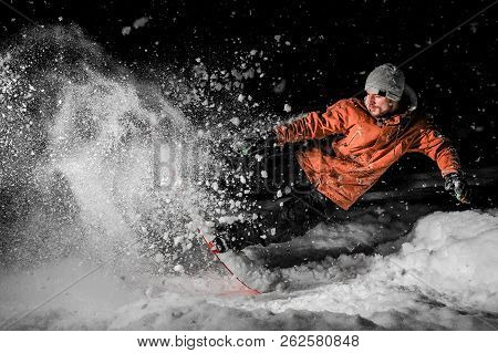 Young Snowboarder In Orange Sportswear