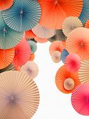 Traditional Asian paper umbrellas with white space