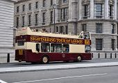 LONDON â?? SEPTEMBER 24: A London Open-top Sightseeing Bus Tour is parked near the Horse Guard Build