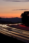 Rush hour traffic at twilight on a busy and fast moving freeway or highway