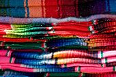 Colorful mexican blankets for sale in the mercado by vendors