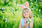 Cute Funny Girl With Easter Eggs And Bunny Ears At Garden. Easter Concept. Laughing Child At Easter poster