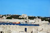 The port and walled ancient city of Rhodes in Greece