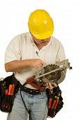 Carpenter checking teeth on circular saw