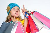 Get Promo Code. Shopping On Black Friday. Girl Amazed Face Knitted Hat Hold Shopping Bags White Back poster