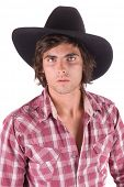 young man in western outfit of a plaid shirt and black cowboy hat